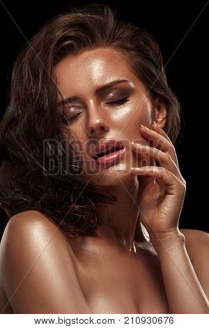 Beauty Girl With Bronze Skin Color And Moist Shiny Skin. Wet Hair And Clean Skin, Pink Lipstick On T