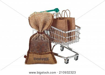 A shopping trolley with bags and a bag of coffee. A great image for advertising coffee. Image isolated on white background.