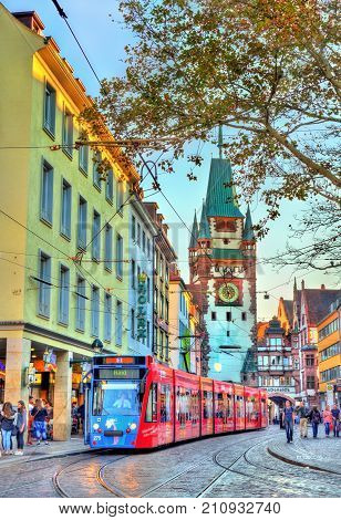 Freiburg im Breisgau, Germany - October 14, 2017: Siemens Combino tram in the old town. The Freiburg tram network consists of 5 lines with 73 stops.