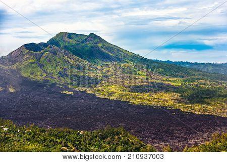 The volcanic mountain on the shore of the lake on the there are traces of petrified lava. Danau Batur, Gunung Batur, Kintamani, Bali, Indonesia.