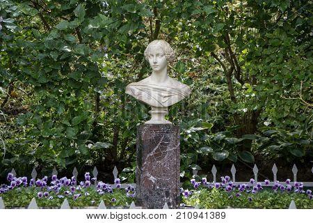 PETERHOF, SAINT-PETERSBURG, RUSSIA - JUNE 10, 2016: Marble bust of the Grand Duchess Alexandra in Petergof.