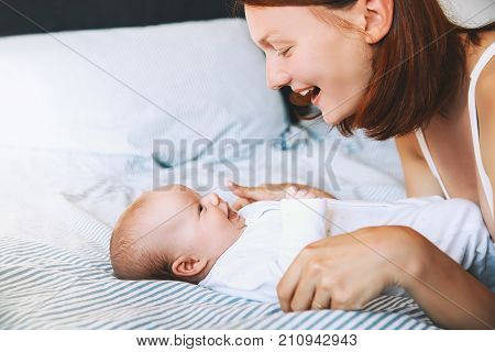 Mother and baby. Mom spend time with her little child at home. Image of happy maternity and family.