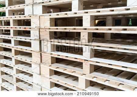 Stack Of Wooden Pallets In Factory Warehouse