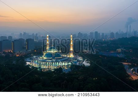 Aerial view of Federal Territory Mosque during sunrise. Federal Territory Mosque is a major mosque in Kuala Lumpur Malaysia