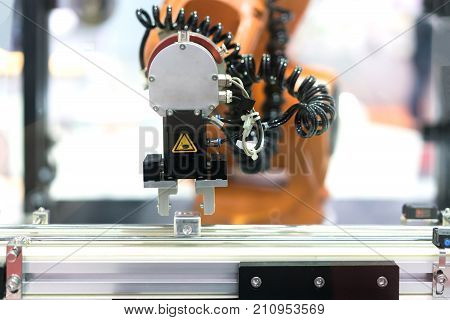 Automatic robot arm with imaging sensor in assembly line working in factory. Smart factory industry 4.0 concept.