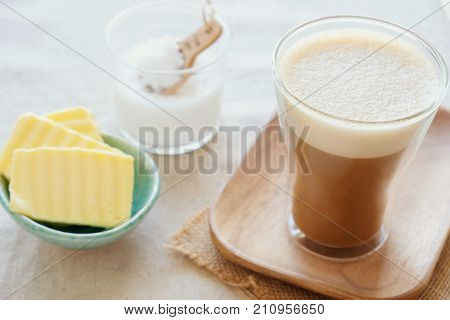 bulletproof coffee blended with organic grass fed butter and MCT coconut oil paleo keto ketogenic drink breakfast poster