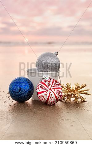 Christmas Decorations at Carlsbad State Beach at Sunset on the background of Sea in San Diego Winter Holiday Concept Selective Focus