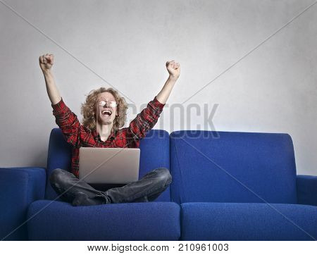 Jubilant guy using a laptop