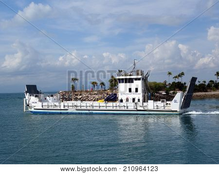Magnetic Island, Queensland, Australia-September 1, 2017:  A close up view of barge leaving the marina at Magnetic Island
