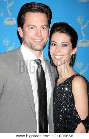 LOS ANGELES - JUN 17:  Michael Muhney & wife arrive at the 38th Annual Daytime Creative Arts & Entertainment Emmy Awards at Westin Bonaventure Hotel on June 17, 2011 in Los Angeles, CA