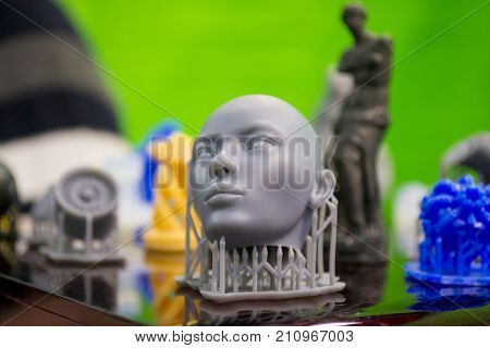 Objects photopolymer printed on a 3d printer. Stereolithography 3D printer, technology of liquid photopolymerization under UV light. Progressive modern additive technology 3D printing.