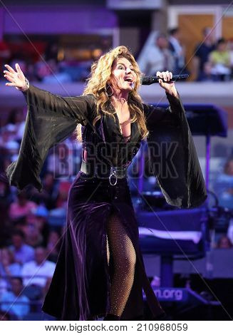 NEW YORK - AUGUST 28, 2017: Canadian country singer and songwriter Shania Twain performs at 2017 US Open opening night ceremony at National Tennis Center in New York