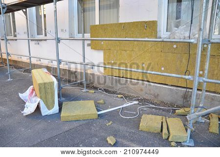 External wall insulation. Solid wall insulation. Energy efficiency house wall renovation for energy saving. Exterior house wall heat insulation with mineral wool.