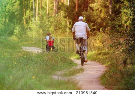 active senior with grandkids riding bikes in nature, active retirement