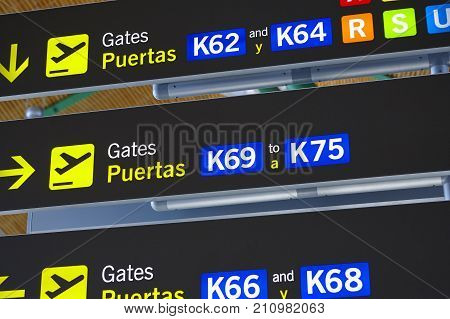 Airport information sign post. Departure gates. Travel background.