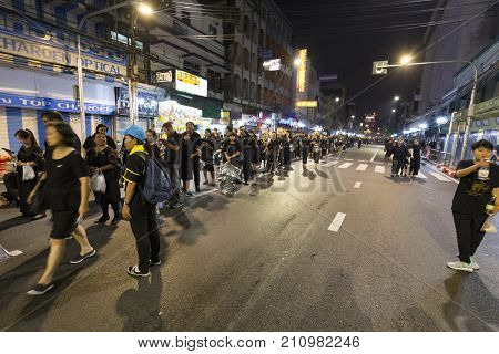 BANGKOK THAILAND - OCTOBER 26: Unidentified people stand in line to make merit for the cremation of Rama IX near Khao San Road in Bangkok Thailand on October 26 2017.