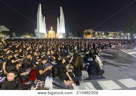 BANGKOK THAILAND - OCTOBER 26: Unidentified people gather for the cremation of Rama IX at night on Ratchadamnoen Avenue next to Democracy Monument in Bangkok Thailand on October 26 2017.