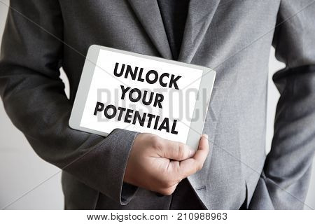 Unlock Your Potential  Businessman Hand Working Concept For Growth