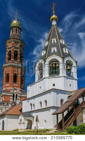 Bell Tower Of St. John The Theologian Monastery In The Background Of Clear Sky