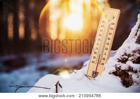 thermometer with sub-zero temperatures in the winter forest