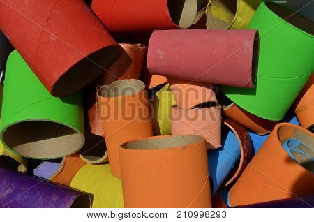 Kids handcraft multi colored paperboard tubes background poster