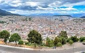 High view of Quito, from the Panecillo hill, on a cloudy and overcast afternoon. Quito, Ecuador. poster
