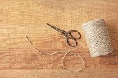 Hank of hemp twine on wooden background poster