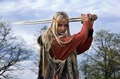 Viking girl warrior with sword in a wood poster
