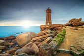 Stunning sunset with lighthouse of Ploumanach Mean Ruz in Perros-Guirec on Pink Granite Coast, Brittany, France, Europe poster