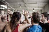 Successful People Giving High Five To Each Other In Gymnasium poster