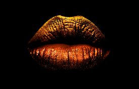 Golden Brown Lipstick On Lips Isolated On Black Background. Sexy Lips, Female Mouth. Imprint Lips. L