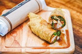 Fresh Tortilla Wraps With Chicken And Fresh Vegetables On Chopping Board