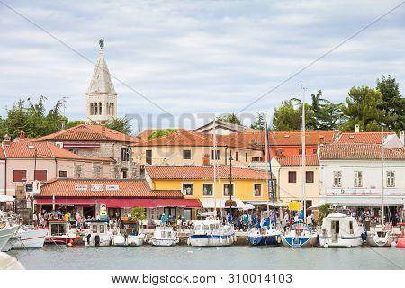 Novigrad, Istria, Croatia, Europe - September 3, 2017 - Sailing Ships And Motorboats At The Harbor O