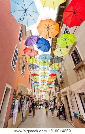 Novigrad, Istria, Croatia, Europe - September 3, 2017 - Tourists Walking Through The Old Town Of Nov