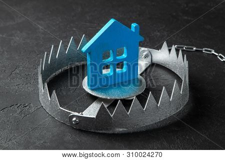 Trap With Bait House. The Risk Of Buying An Old House. Dangerous Mortgage. Home Insurance. Black Bac