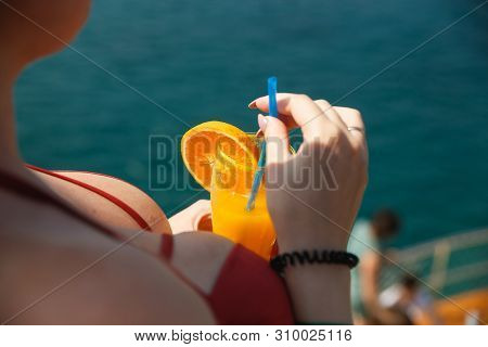 Sexy Busty Woman On Yacht. Lady In Girl In Coral Bra Holding Fresh Orange Drink. Cool Drink And Fres