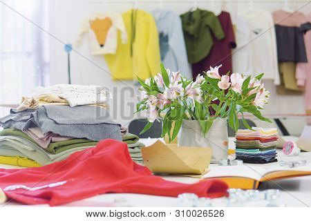 Creative Fashion Designer Desk Or Workplace With Sewing Equipment, Fabrics, Templates, Modern Stylis