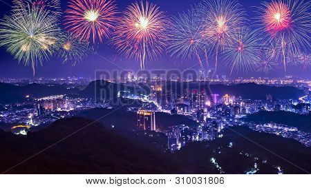 Firework With Cityscape Night Light View Of Taipei. Taiwan City Skyline At Twilight Time