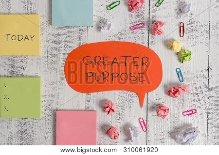Word writing text Greater Purpose. Business concept for Extend in average conforming the moral order of the universe Blank speech bubble paper balls clips sticky notes old wooden background. poster