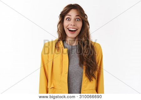 Speechless fascinated cute female fan girl open mouth drop jaw impressed smiling toothy stare camera shocked thrilled excited see pop star standing white background cheerful hold breath amused poster