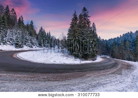 Empty Serpentine Road In Mountains. Spruce Trees Along The Way. Beautiful Transportation Scenery In