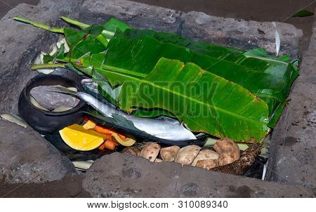 Easter Island Tipical Food Fish Tuna, Seafood, Chicken, Meat And Sweet Potatoes Prepared Over Hot St