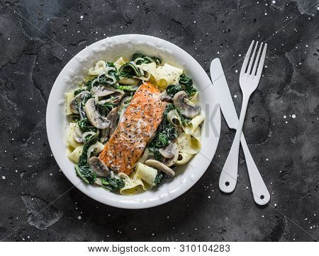 Pappardelle Pasta With Creamy Spinach Mushrooms Sauce And Baked Salmon On A Dark Background, Top Vie