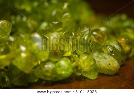 August Birthstone Olive Green Peridot, Natural Stone Gravel Close Up.