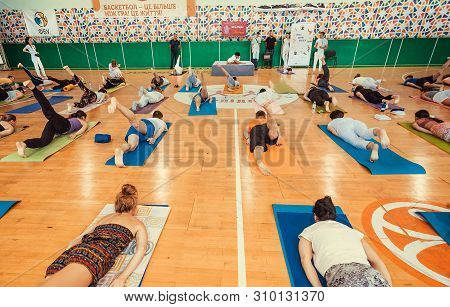 Kyiv, Ukraine: People On Floor Doing Yoga Asana And Some Exercises, In Group Of Active Sport Persons