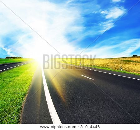 Asphalt Road Over Blue Sky
