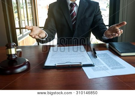 Lawyer Present Client With Contract Papers On The Table In Office. Consultant Lawyer, Attorney, Cour