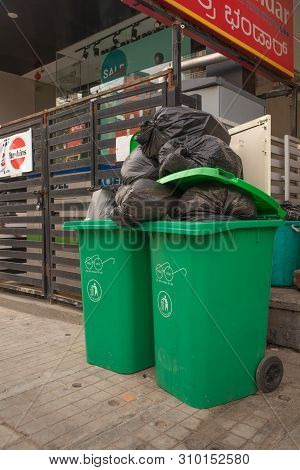 Bengaluru, India June 27, 2019 : Green Big Trash Box With Swachh Bharat Printed On Them, Green Litte