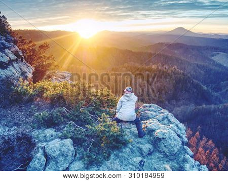 Woman Photographer Works. Professional Artist Takes Photos With Mirror Camera And Tripod On Peak Of