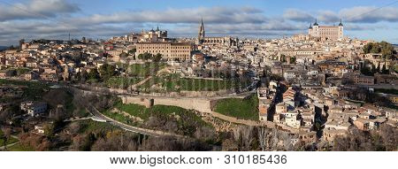 Panoramic View Of Toledo, Spain. Alcazar And The Ancient City On A Hill Over The Tagus River, Castil